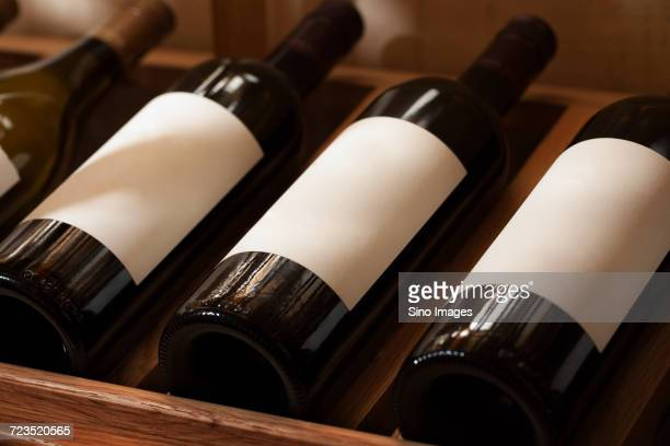 Wine bottles with blank labels in wine rack