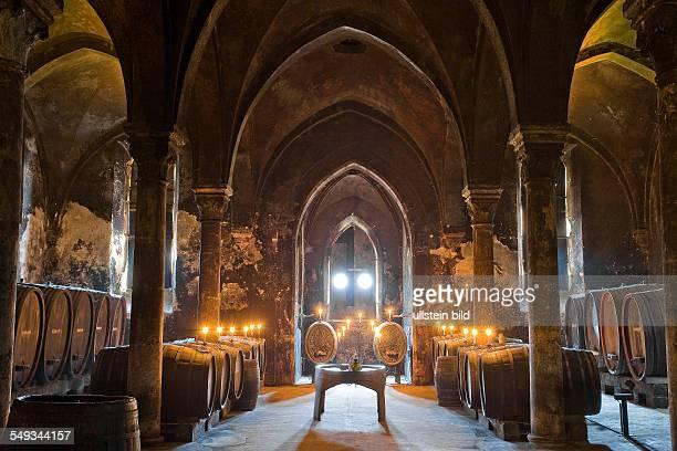 Wine casks in an old wine cellar of Eberbach Monastery in Eltville/Rhine Hesse Germany
