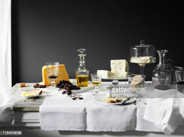 wine, cheese and bread on table - still life stock pictures, royalty-free photos & images