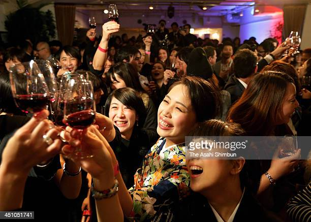 Wine connoisseurs toast the midnight release of the 2013 Beaujolais Nouveau vintage at a restaurant on November 21 2013 in Tokyo Japan The guests...