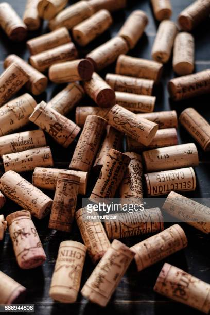 wine corks with brand names and logos. - cork stopper stock photos and pictures