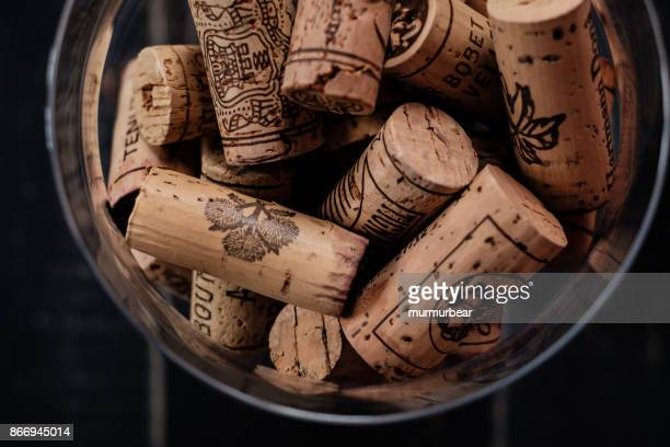 wine corks with brand names and logos. - bottle stopper stock photos and pictures
