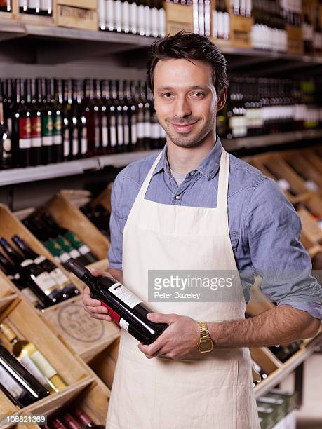 wine expert in supermarket - apron stock pictures, royalty-free photos & images