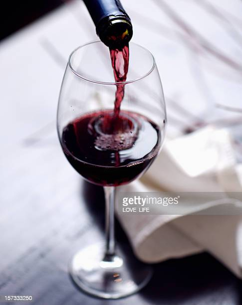 wine pour - red wine stock pictures, royalty-free photos & images