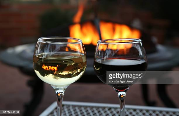 wine for two by the outdoor firepit - fire pit stock pictures, royalty-free photos & images