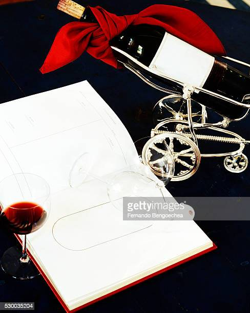 a wine glass and a winebottle are placed beside a book - fernando bengoechea stock pictures, royalty-free photos & images