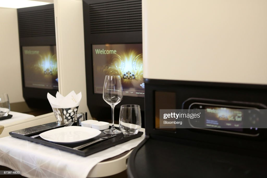A wine glass and tableware sit inside the first class cabin of an Airbus SE A380 passenger aircraft, operated by Etihad Airways PJSC, during the 15th Dubai Air Show at Dubai World Central (DWC) in Dubai, United Arab Emirates, on Monday, Nov. 13, 2017. The biennial Dubai expo is an important venue for manufacturers to secure deals for their biggest and most expensive jetliners. Photographer: Natalie Naccache/Bloomberg via Getty Images