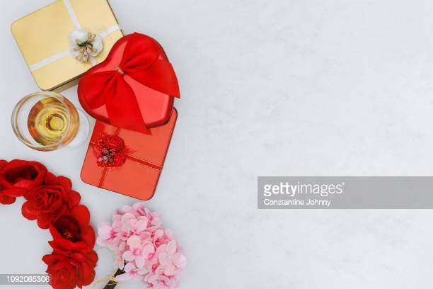 Wine Glass, Gift Boxes and Flower on White Background