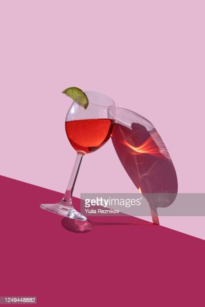 wine glass on the red-pink background - wine stock pictures, royalty-free photos & images