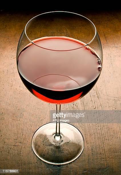 Wine glass on wood