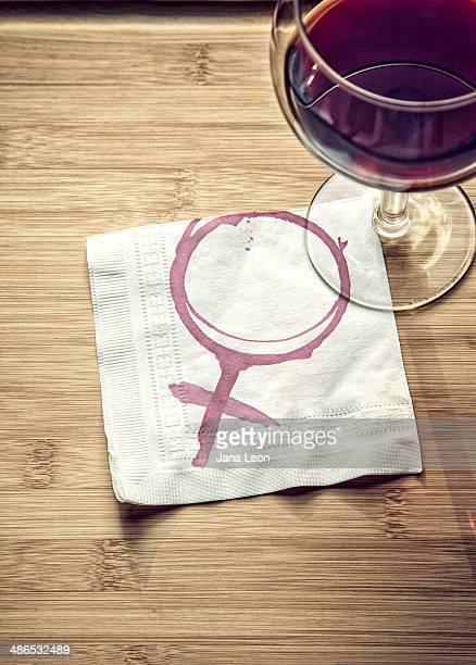 Wine glass with female symbol on napkin.