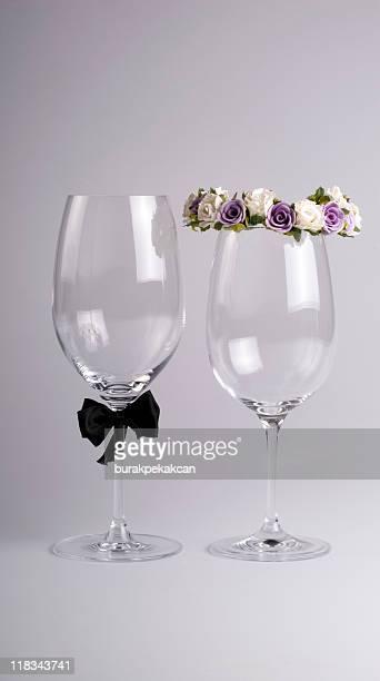 Wine glasses dressed as bride and groom