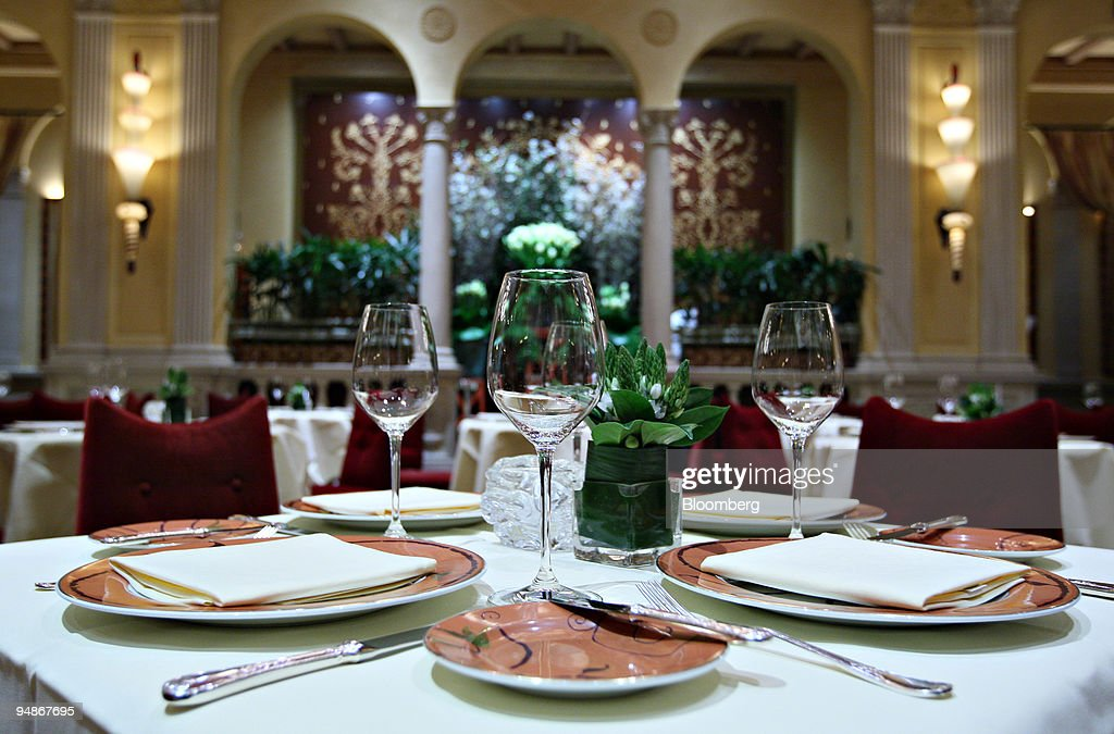 Wine glasses sit on a table inside Daniel restaurant in New : News Photo