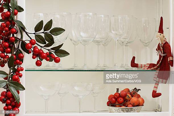 Wine glasses with festive Christmas decorations