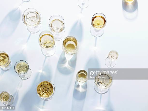 wine glasses with white wine on white tablecloth - wine glass stock pictures, royalty-free photos & images