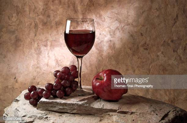 wine grapes and apple still life -  firak stock pictures, royalty-free photos & images