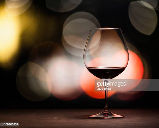 wine in party background - red wine stock pictures, royalty-free photos & images