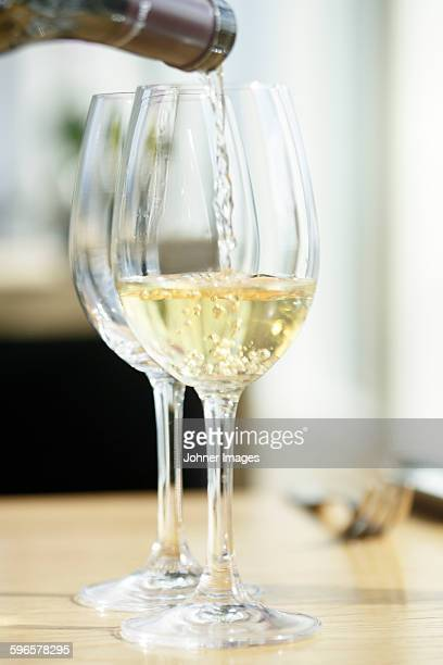 Wine is poured into wineglass