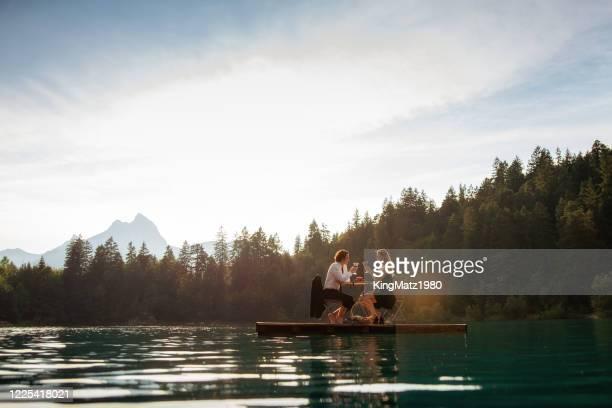 wijn op het meer - oostenrijk stockfoto's en -beelden