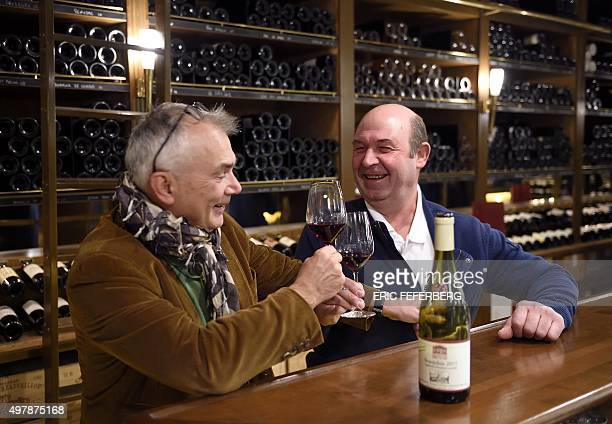 Wine producer Pierre Marie Chermette and merchant Frederic Desclaux toast to celebrate the release of the beaujolais wine harvest on November 19 2015...