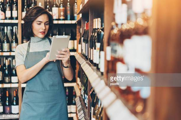 Wine shop manager with digital tablet