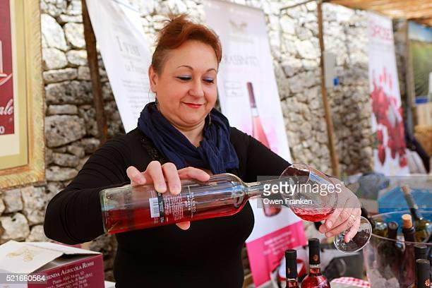 wine tasting at a farmers' products fair, Locorotondo, Puglia, Italy
