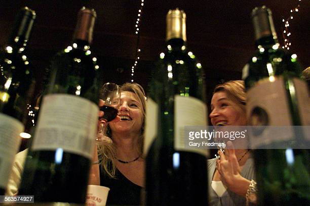 A wine tasting is held at Wine House on 1/18/2002 where wine tasters tasted Cabernet wines Natalie Bell and Lesley Vicari partake in the Cabernet...