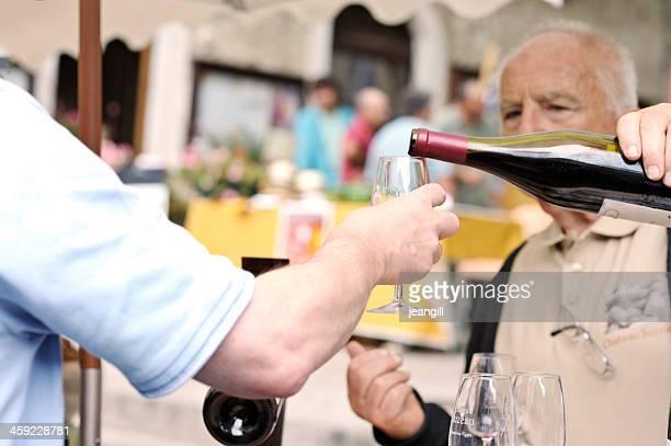 Wine tasting on French market stall