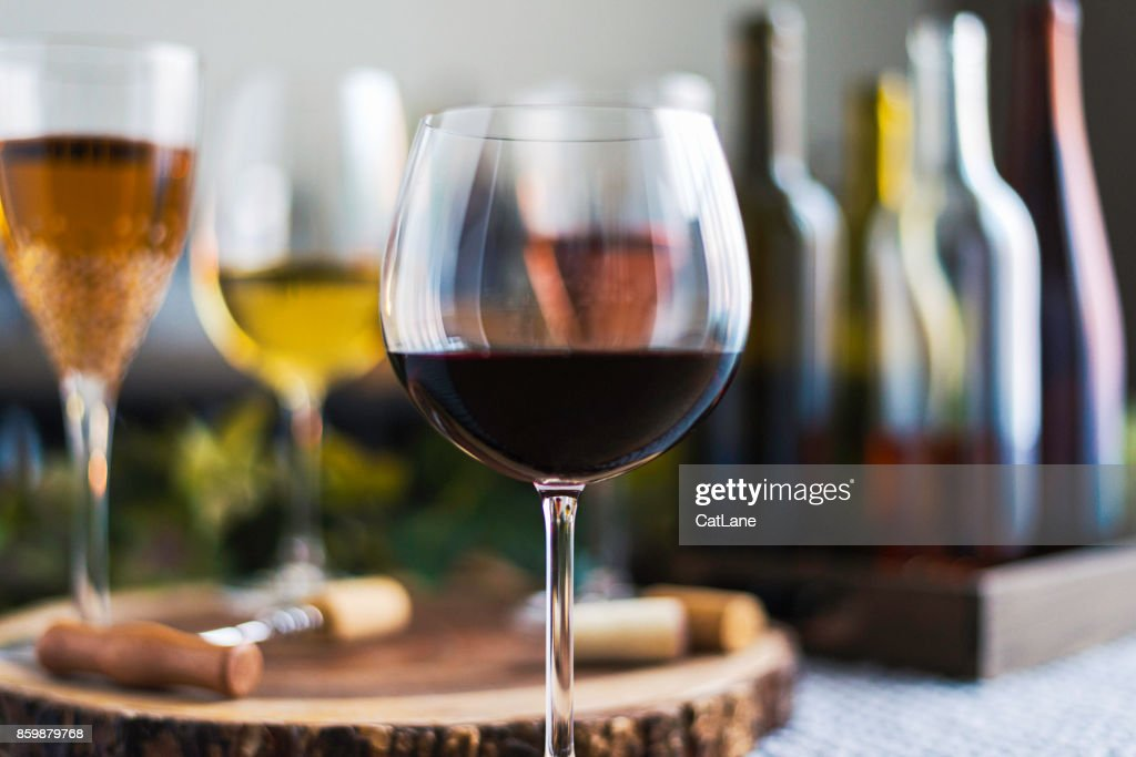 Wine tasting theme with various bottles of wine and glasses : Stock Photo