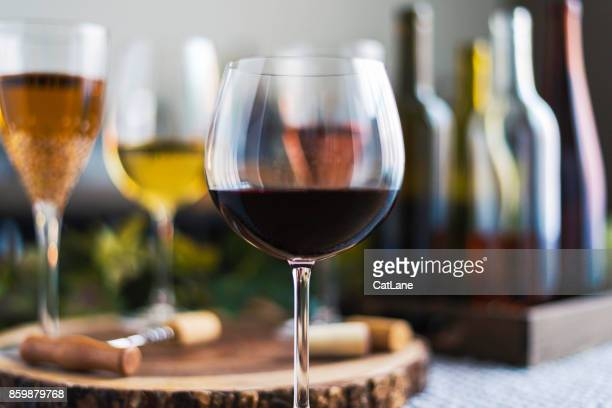 wine tasting theme with various bottles of wine and glasses - wine glass stock pictures, royalty-free photos & images