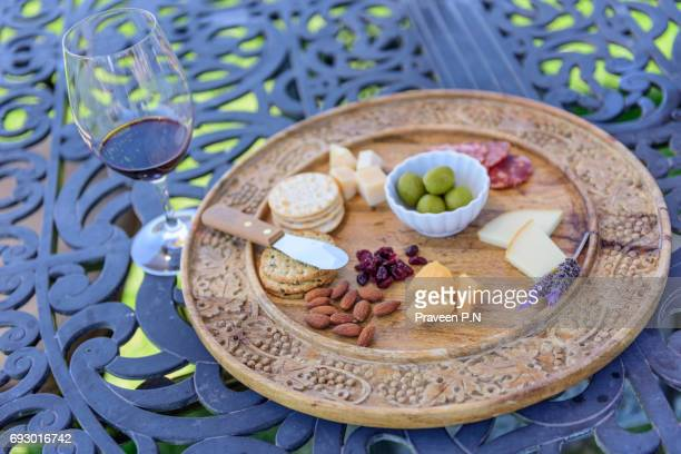 Wine tasting with cheese, crackers, and nuts