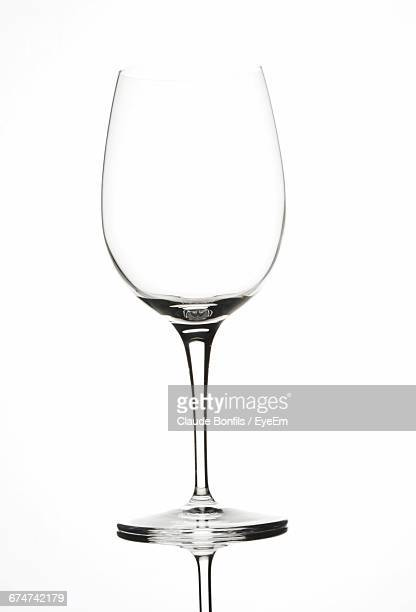 wineglass against white background - wine glass stock photos and pictures