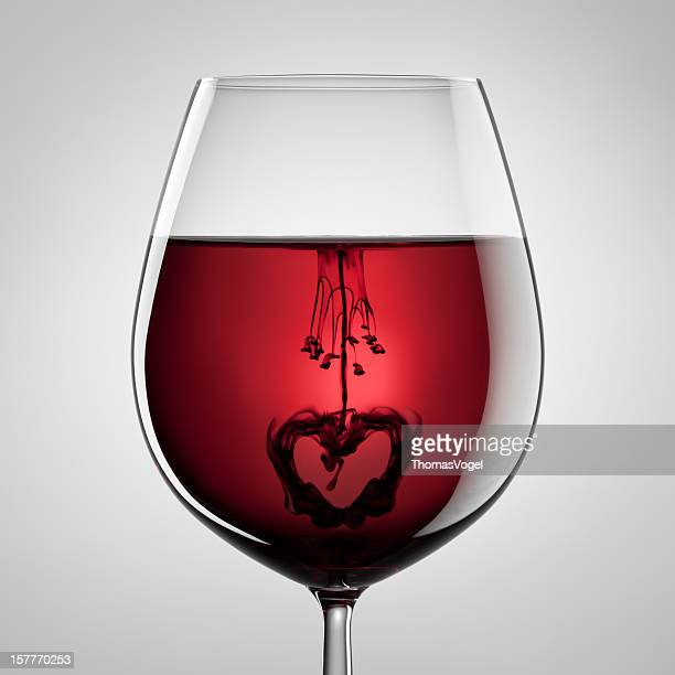Wineglass, red wine, black ink and heart. Abstract love art
