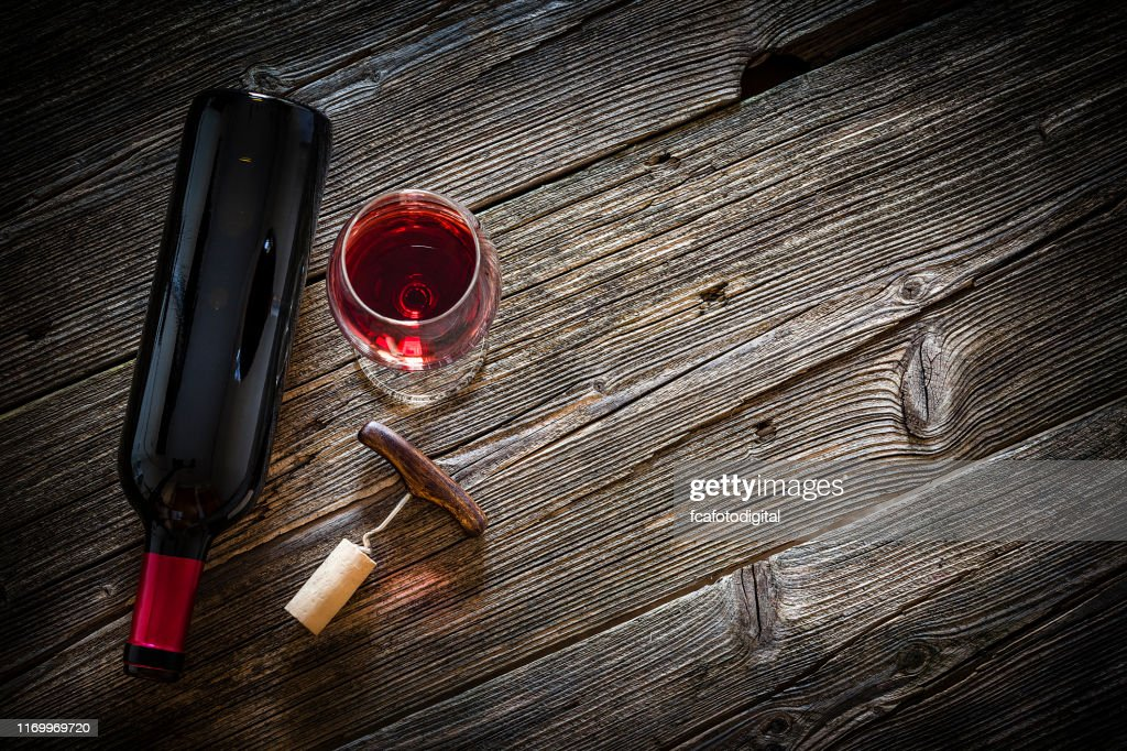 Wineglass, wine bottle, vintage corkscrew and cork stopper : Stock Photo
