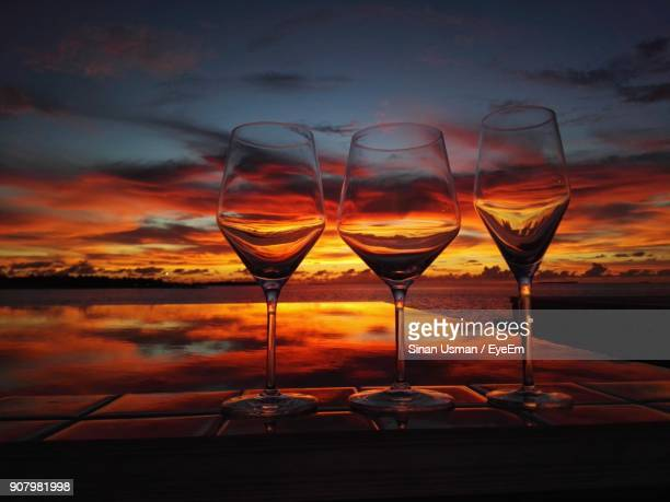 Wineglasses Against Sea During Sunset