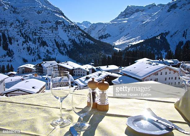 Wineglasses On Table At Restaurant Against Arlberg