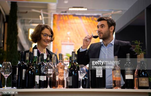 Winegrowers enjoy a Languedoc wine at the Wine Paris exhibition exhibition at Paris Expo Porte de Versailles in Paris on February 11 2019 From...