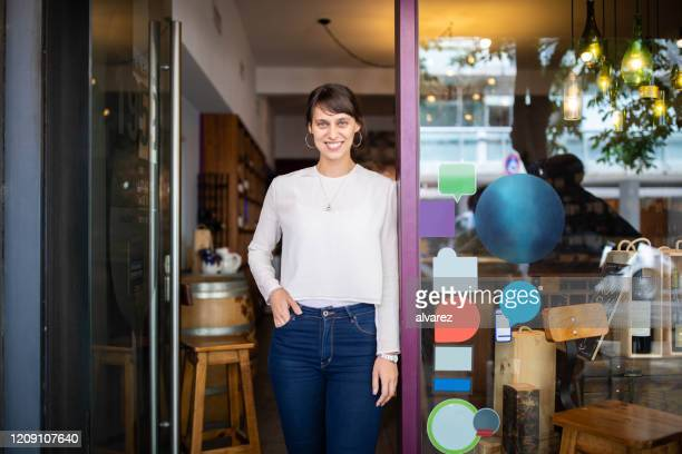 winery store owner standing at door of her shop - franchising stock pictures, royalty-free photos & images