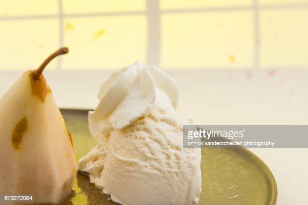 Wine-steamed Durondeau pear, sauce and ice cream served on platter.