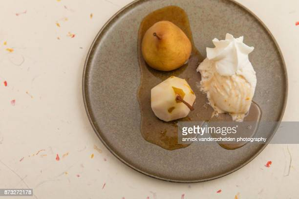 Wine-steamed Durondeau pear, sauce, ice cream and whipped cream served on platter.