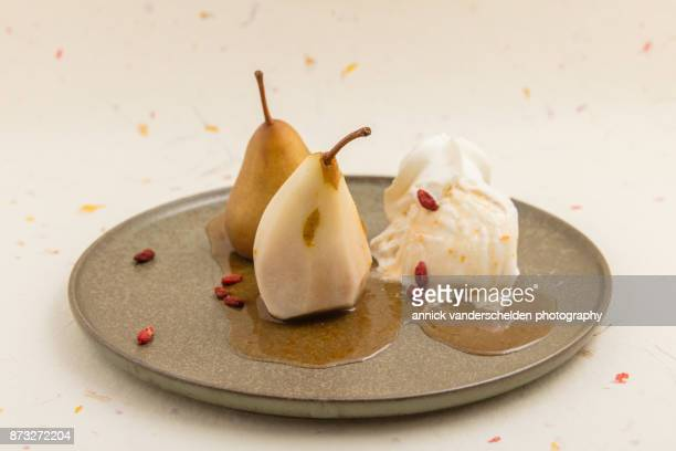 Wine-steamed Durondeau pears, sauce, ice cream and whipped cream and goji.