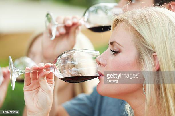 Winetasting Woman and Man Drinking, Sipping, Tasting Winery Red Wine