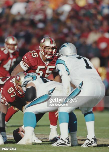 Winfred Tubbs Linebacker for the San Francisco 49ers keeps his eye on Steve Beuerlein Quarterback for the Carolina Panthers during their National...
