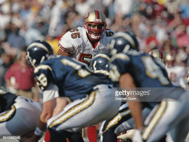 Winfred Tubbs Linebacker for the San Francisco 49ers looks across the line of scrimmage to Quarterback Ryan Leaf of the San Diego Chargers during...