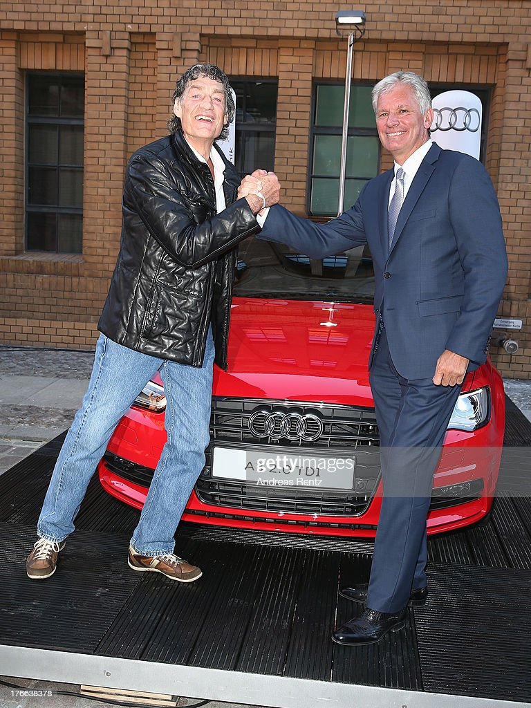 Winfried Glatzeder and Alexander Schuhmacher (Head of Sales Region East, Audi) attend the 12th Audi Classic Open Air during the AUDI Sommernacht at Kulturbrauerei on August 16, 2013 in Berlin, Germany.