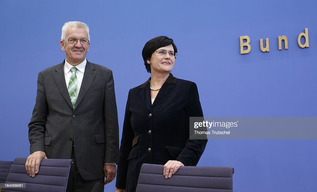 Winfried Kretschmann, Minister-President of the state of Baden-Wuerttemberg (L) and Christine Lieberknecht, Minister-President of the state of Thuringia, arrive for a press conference at Bundespressekonferenz on October 11, 2013 in Berlin, Germany.