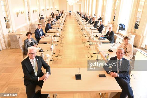 Winfried Kretschmann , Prime Minister of Baden-Wuerttemberg and Thomas Strobl , Minister of the Interior of Baden-Wuerttemberg, sit in the first...