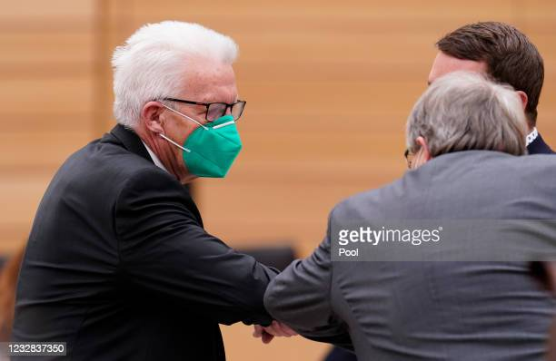 Winfried Kretschmann, the Greens Party premier of Baden-Wuerttemberg, , welcomes MPs at the beginning of the meeting at the Baden-Wuerttember state...