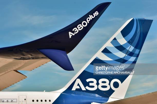 A wing and the tail of an Airbus A380 are pictured at the International Paris Air Show in Le Bourget outside Paris on June 20 2017 / AFP PHOTO /...