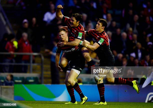 Wing Chris Ashton of Saracens is congratulated by teammate Brad Barritt and Joel Tomkins after scoring his team's second try during the Heineken Cup...